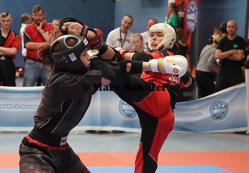 Falcon Fighters Schwalmeder (schwarz) gegen Fire Devils Feuerfighter (rot) - Gräfenhausen 21.09.2019: Kick-Box Meisterschaft bei der SKG Gräfenhausen