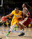 SIOUX FALLS, SD - MARCH 7: Lawrence Alexander #12 from North Dakota State University drives against Cam Delaney #2 from Denver in the first half of their Summit League Tournament game Saturday night at the Denny Sanford Premier Center in Sioux Falls, SD. (Photo by Dave Eggen/Inertia)