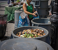 Compost Collection at the Greenmarket in Union Square in New York on Saturday, June 22, 2013. After a pilot program New York Mayor Michael Bloomberg has proposed mandatory composting requiring New Yorkers to separate items such as chicken bones and eggshells from the rest of their household trash. Opponents of the program, meant to reduce the amount of waste carted off to landfills, point out that most buildings in New York do not have the room for composting and the inevitable vermin problem that will go along with it. (© Richard B. Levine)