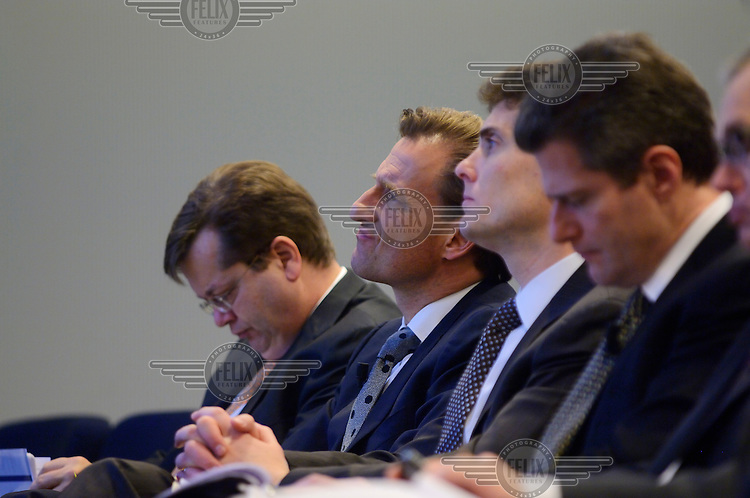 Senior bankers at Credit Suisse attend a press conference to announce their annual results, which were disappointing, causing a drop in shareprices. At centre is Walter Berchtold, Chief of Private Banking. The Swiss banking industry holds an estimated 4,000 billion Swiss Francs (USD 4,240 billion) in assets, more than half of it foreign, including CHF 880 billion in undeclared European assets alone, benefiting from the country's famous banking secrecy laws.
