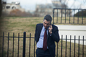 CNN Correspondent Jim Acosta speaks on the phone outside the White House Press Room on December 7th, 2017. <br /> Credit: Alex Edelman / CNP
