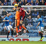07.04.2018 Rangers v Dundee:<br /> Wes Foderingham takes an elbow from Sofien Moussa