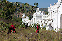 Myanmar, Burma.  Mingun, near Mandalay.  Two Young Novice Bhuddist Monks Leaving the Hsinbyume Paya, a Stupa Built in 1816.