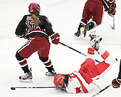 Samantha Reber (Harvard - 12), Kayla Tutino (BU - 8) - The Boston University Terriers defeated the Harvard University Crimson 5-2 on Monday, January 31, 2012, in the opening round of the 2012 Women's Beanpot at Walter Brown Arena in Boston, Massachusetts.