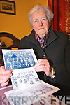 Bride Roper secretary of the Pioneer Total Abstinence Association Cahersiveen with some old photos of from the early 40's of the girls from the Presentation Convent School Cahersiveen who took their pledges.