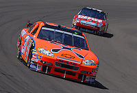 Apr 19, 2007; Avondale, AZ, USA; Nascar Nextel Cup Series driver Jeff Burton (31) leads Carl Edwards (99) during practice for the Subway Fresh Fit 500 at Phoenix International Raceway. Mandatory Credit: Mark J. Rebilas