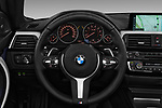 Car pictures of steering wheel view of a 2018 BMW 4 Series M Sport 2 Door Convertible