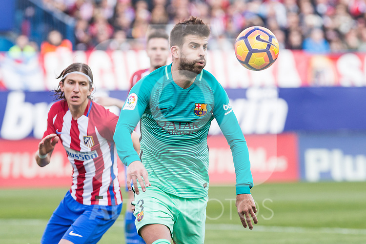 Gerard Pique of Futbol Club Barcelona in action during the match of Spanish La Liga between Atletico de Madrid and Futbol Club Barcelona at Vicente Calderon Stadium in Madrid, Spain. February 26, 2017. (ALTERPHOTOS)