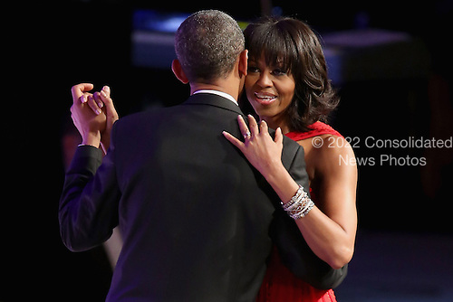 United States President Barack Obama and first lady Michelle Obama dance during the Commander-In-Chief Ball at the Walter Washington Convention Center January 21, 2013 in Washington, DC. President Obama started his second term by taking the Oath of Office earlier in the day during a ceremony on the West Front of the U.S. Capitol. .Credit: Chip Somodevilla / Pool via CNP