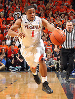 Feb. 16, 2011; Charlottesville, VA, USA; Virginia Cavaliers guard Jontel Evans (1) goes after a loose ball during the second half of the game against the Duke Blue Devils at the John Paul Jones Arena. The Duke Blue Devils won 56-41.  Credit Image: © Andrew Shurtleff