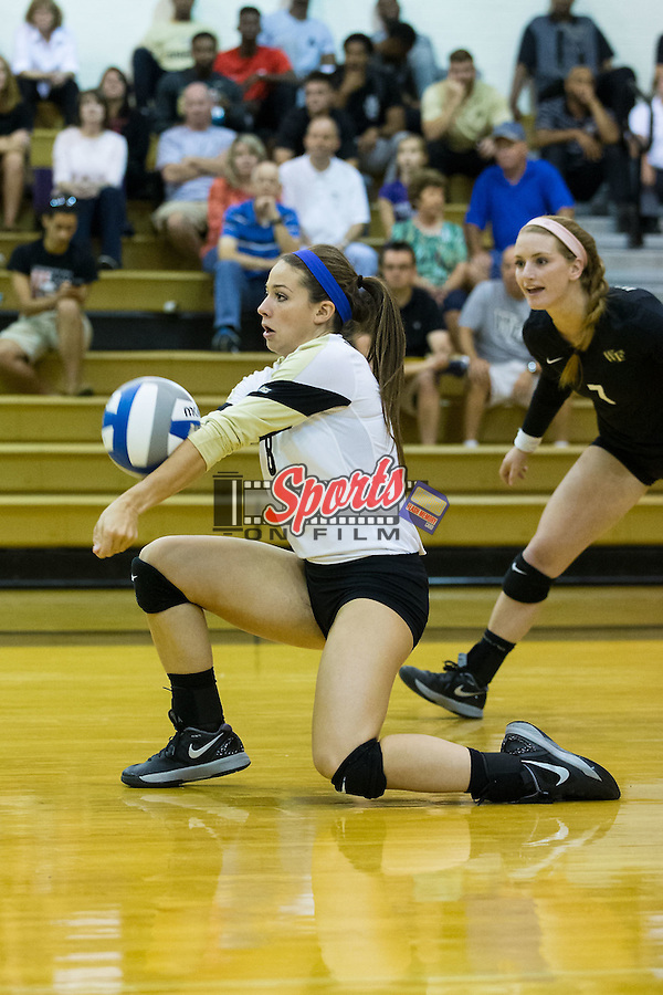 Hailey Brooke McFadden (8) of the Wake Forest Demon Deacons digs the ball against the Georgia Bulldogs in Reynolds Gymnasium on September 18, 2015 in Winston-Salem, North Carolina.  The Demon Deacons defeated the Bulldogs 3-1.   (Brian Westerholt/Sports On Film)