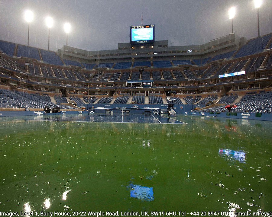 Rain Stops play during the men's singles final between Rafael Nadal (ESP) (1) and Novak Djokovic (SRB) (3)...International Tennis - US Open - Day 15 - 13 Sep 2010 - USTA Billie Jean King National Tennis Center - ..© AMN Images, Level 1, Barry House, 20-22 Worple Road, London, UK, SW19 6HU.Tel - +44 20 8947 0100.email - mfrey@advantagemedianet.com.web - http://amnimages.photoshelter.com/.web - www.advantagemedianet.com