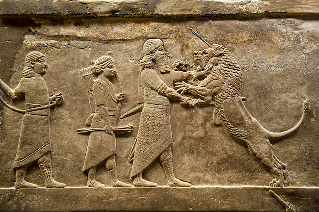Assyrian relief sculpture panel of Ashurnasirpal lion hunting.  From Nineveh  North Palace, Iraq,  668-627 B.C.  British Museum Assyrian  Archaeological exhibit no  ME 124875.