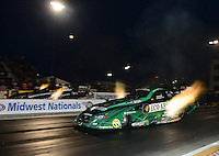 Sept. 28, 2012; Madison, IL, USA: NHRA funny car driver Todd Lesenko (near lane) races alongside Terry Haddock during qualifying for the Midwest Nationals at Gateway Motorsports Park. Mandatory Credit: Mark J. Rebilas-