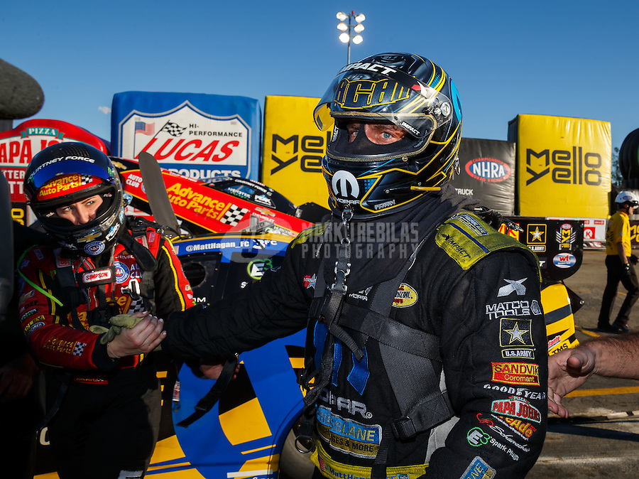 Feb 12, 2017; Pomona, CA, USA; NHRA funny car driver Courtney Force (left) congratulates Matt Hagan as he celebrates after winning the Winternationals at Auto Club Raceway at Pomona. Mandatory Credit: Mark J. Rebilas-USA TODAY Sports
