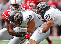 Ohio State Buckeyes linebacker Joshua Perry (37) tackles Kent State Golden Flashes quarterback Colin Reardon (10) in the 1st quarter of their game in Ohio Stadium on September 13, 2014.  (Dispatch photo by Kyle Robertson)