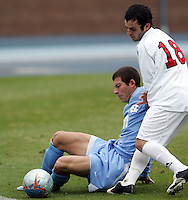 UNC's David Boole (17) shields SMU's Chase Wileman (18) as the ball trickles over the touch line. Southern Methodist University defeated the University of North Carolina 3-2 in double overtime at Fetzer Field in Chapel Hill, North Carolina, Saturday, December 3, 2005.
