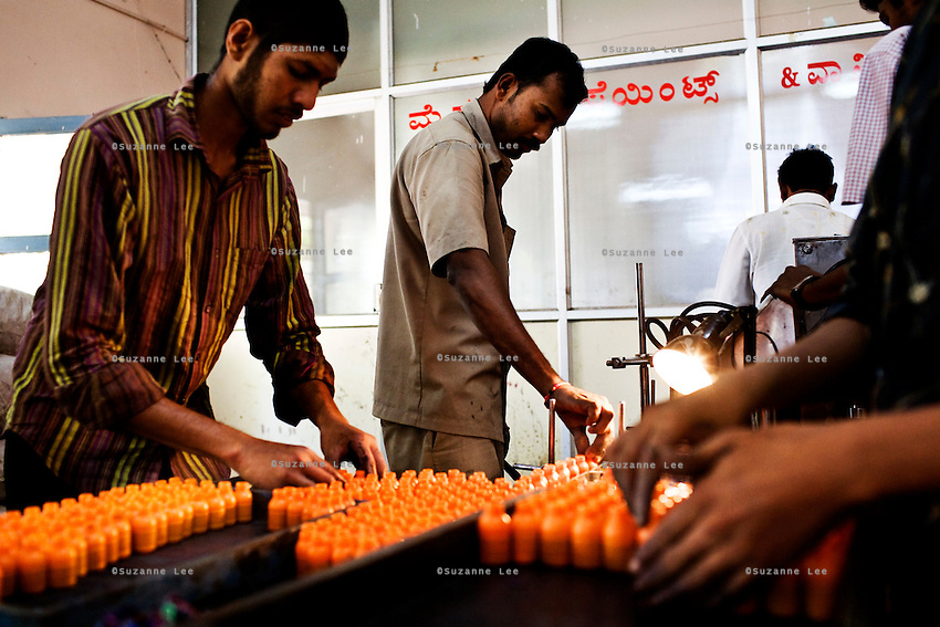 30th March 2009, Mysore, Karnataka, India: Factory workers arrange the plastic phials that contain 10ml of indelible ink on trays to be sent to the sealing section. .Indelible Ink used for the upcoming 2009 India Lok Sabha Elections have been filled into the 15ml capacity phials. In each phial, 10ml of ink is filled, and if properly applied, can be used to mark as many as 700 voters. Only one company, Mysore Paints and Varnish, manufactures the secret formula of indelible ink that is used for all Indian elections since the biggest democratic nation in the world started using ink to mark the fingers of its voters in 1962.   Photo by Suzanne Lee/The National