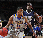SIOUX FALLS, SD - MARCH 5:  George Marshall #11 of South Dakota State dribbles into defender Obe Emegano #15 of Oral Roberts in the 2016 Summit League Tournament.  (Photo by Dick Carlson/Inertia)
