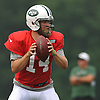 Ryan Fitzpatrick #14, New York Jets quarterback, takes a snap during training camp at Atlantic Health Jets Training Center in Florham Park, NJ on Saturday, July 30, 2016.