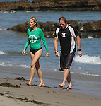 .9-8-09.Tuesday Exclusive...Helen Hunt soaking up the rays wearing a black bikini & a green peace t-shirt in Malibu California. Helen was running & playing on the beach with her husband & kids. The family went swimming out in the ocean & it looks like Helen could be pregnant showing off a little baby bump. ...AbilityFilms@yahoo.com.805-427-3519.www.AbilityFilms.com.