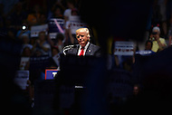Richmond, VA - June 10, 2016:  Republican presidential candidate and businessman Donald J. Trump speaks at a campaign rally at the Richmond Coliseum in Richmond, VA, June 10, 2016, as supporters raise signs and cheer. Trump is the presumptive nominee for his party, having won the required number of delegates.  (Photo by Don Baxter/Media Images International)