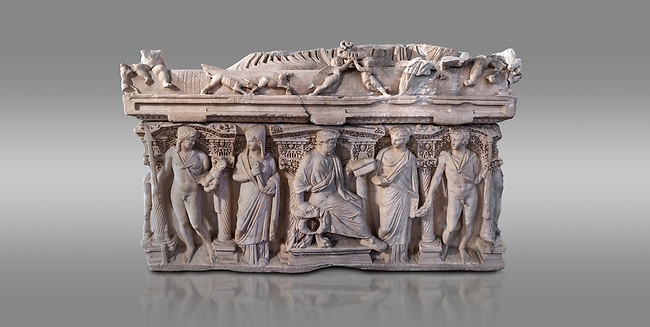 "Side panel of a Roman relief sculpted sarcophagus with kline couch lid, ""Columned Sarcophagi of Asia Minor"" style typical of Sidamara, 3rd Century AD, Konya Archaeological Museum, Turkey. Against a grey background"