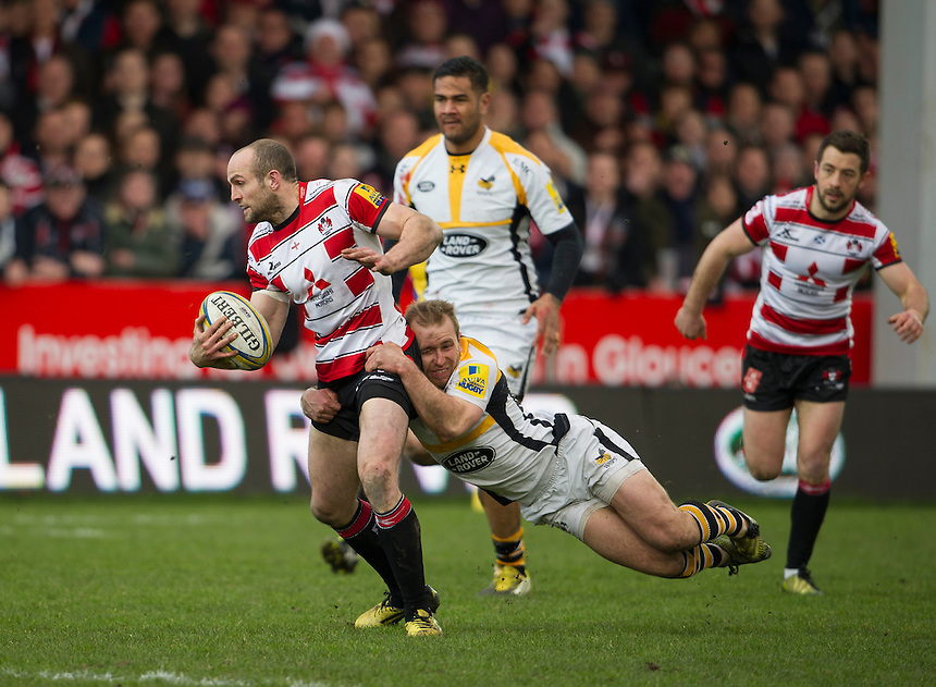 Gloucester Rugby's Charlie Sharples is tackled by Wasps' Dan Robson<br /> <br /> Photographer Ashley Western/CameraSport<br /> <br /> Rugby Union - Aviva Premiership Round 15 - Gloucester Rugby v Wasps - Saturday 5th March 2016 - Kingsholm Stadium - Gloucester<br /> <br /> &copy; CameraSport - 43 Linden Ave. Countesthorpe. Leicester. England. LE8 5PG - Tel: +44 (0) 116 277 4147 - admin@camerasport.com - www.camerasport.com