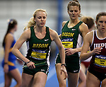 BROOKINGS, SD - FEBRUARY 24:  Jenny Guibert from North Dakota State University takes her leg of the women's distance medley Friday afternoon at the Summit League Indoor Championships in Brookings, SD. (Photo by Dave Eggen/Inertia)