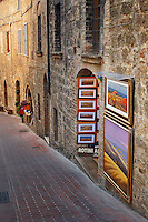 Paintings for sale in small shop, Monteriggioni, Italy