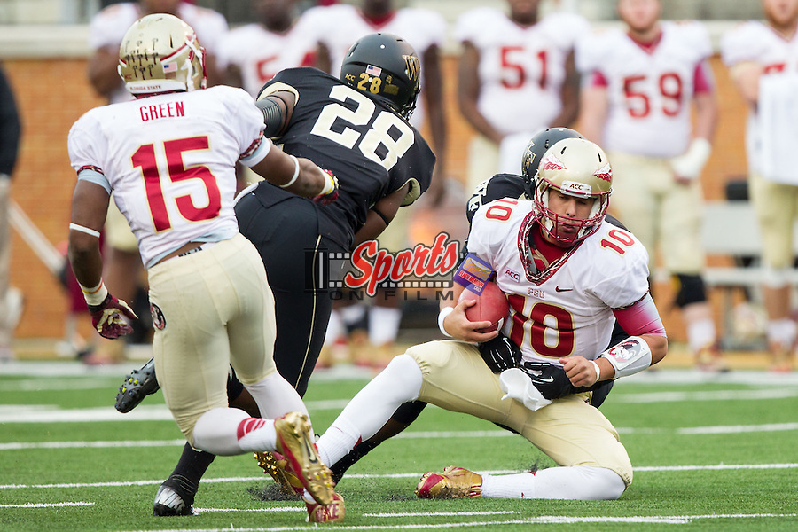 Sean Maguire (10) of the Florida State Seminoles is sacked by Kevis Jones (37) of the Wake Forest Demon Deacons during fourth quarter action at BB&T Field on November 9, 2013 in Winston-Salem, North Carolina.  The Seminoles defeated the Demon Deacons 59-3.    (Brian Westerholt/Sports On Film)