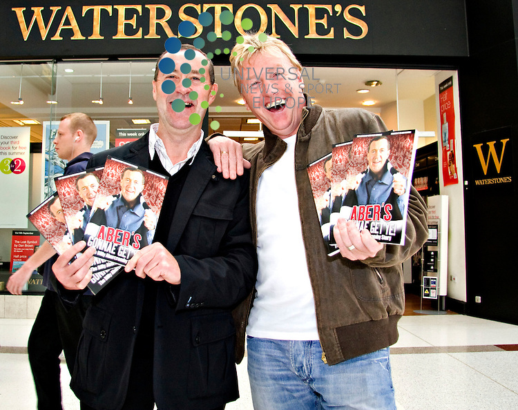 Former Celtic and Scotland star Frank McAvennie joins former. Teammate Billy Abercromby at a book-signing session for Billy's new. autobiography. Waterstones, Braehead Centre, Glasgow. Picture: Artur Drazkowski/Universal News And Sport (Scotland) 7 June 2009.