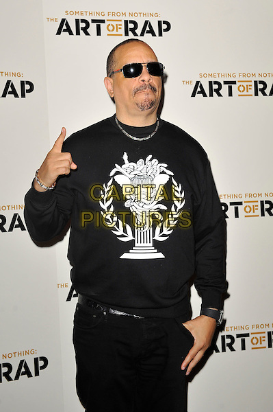 Ice T (Tracy Marrow).'Something For Nothing: The Art of Rap'  European premiere arrivals, Hammersmith Apollo, London, England. 19th July 2012..half length black jumper sweatshirt trousers sunglasses white hand gesture .CAP/MAR.© Martin Harris/Capital Pictures.