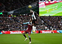 2nd November 2019; London Stadium, London, England; English Premier League Football, West Ham United versus Newcastle United; Allan Saint-Maximin of Newcastle United leaps above Andriy Yarmolenko of West Ham United  to head the ball out - Strictly Editorial Use Only. No use with unauthorized audio, video, data, fixture lists, club/league logos or 'live' services. Online in-match use limited to 120 images, no video emulation. No use in betting, games or single club/league/player publications