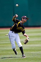 Mikel Mucha (8) of the Wichita State Shockers throws a ball back into the infield during a game against the Missouri State Bears in the 2012 Missouri Valley Conference Championship Tournament at Hammons Field on May 23, 2012 in Springfield, Missouri. (David Welker/Four Seam Images)