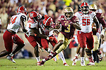 Florida State Seminoles running back Cam Akers (3) cuts through the North Carolina State line on his way to a 41 yard touchdown run in the second half of an NCAA college football game in Tallahassee, Fla., Saturday, Sept. 28, 2019. Florida State defeated North Carolina State 31-13.   (AP Photo/Mark Wallheiser)