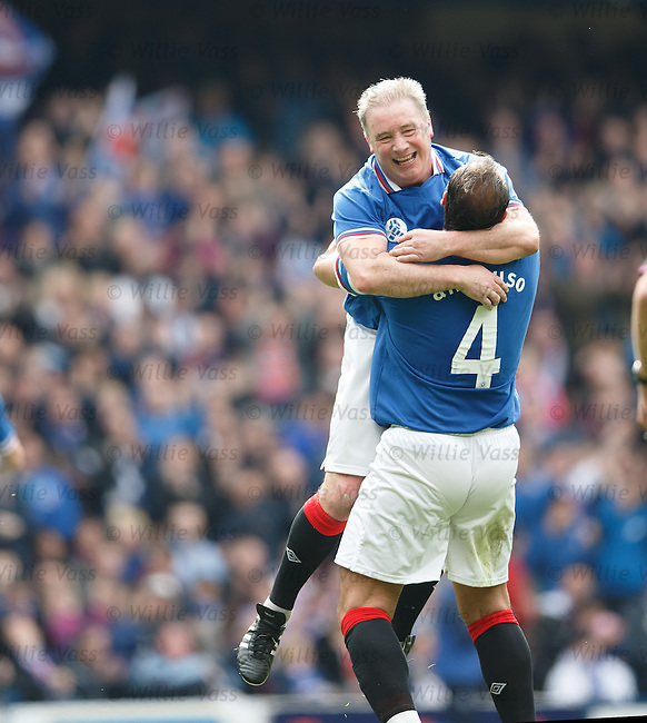 Ally McCoist celebrates his second goal of the match with Lorenzo Amoruso