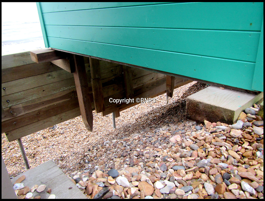 BNPS.co.uk (01202 558833)<br /> Pic:  BNPS<br /> <br /> The shingle has been washed away from underneath the remaining beach huts at the popular beauty spot.<br /> <br /> A group of beach hut owners have been evicted from a coastal beauty spot after a local council refused to replenish a shingle bank that washed away.<br /> <br /> Around 20 owners were last week given their marching orders from Hordle Cliff in Hants after coastal erosion left a 12ft drop outside the timber chalets.<br /> <br /> Some rent-payers were given as little seven days notice to vacate the pebble beach, condemning at estimated £1.1m worth of beach huts to destruction.