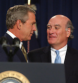 Washington, D.C. - June 23, 2005 -- United States President George W. Bush, left, greets former Secretary of Commerce William Daley, right, after making remarks on the Central American Free Trade Agreement (CAFTA).  Democratic and Republican officials from previous administrations stand with the President in support of the agreement..Credit: Ron Sachs / CNP