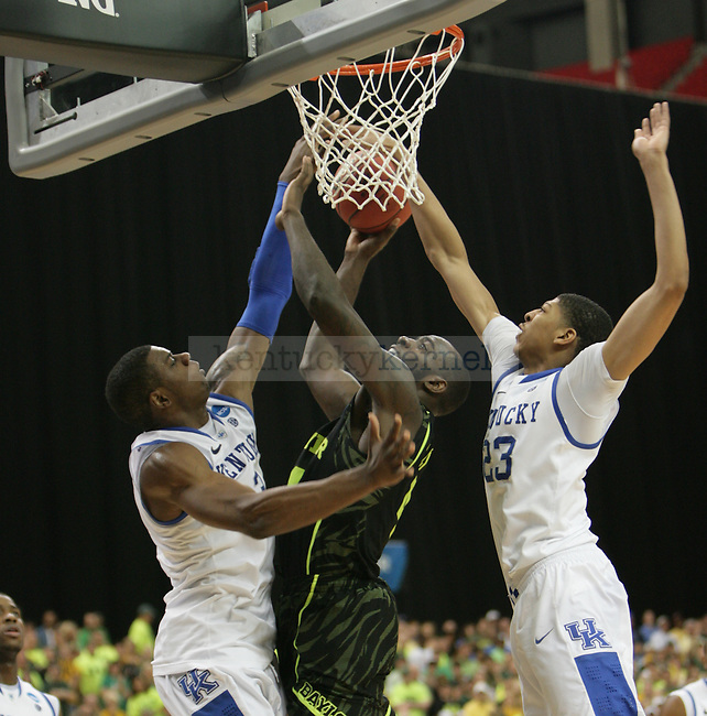 UK players Terrence Jones and Anthony Davis block Baylor's Quincy Acy shot during the second half of the UK vs. Baylor South Regional Finals at the Georgia Dome in Atlanta,  March 25, 2012. UK defeated Baylor 82-70. Photo by Brandon Goodwin | Staff