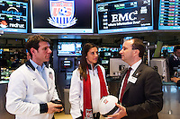 Stefhan Jekel (right), managing director of EMEA talks with U.S. Women's National Team midfielder Carli Lloyd and former U.S. Men's National Team star Jeff Agoos prior to ringing the closing bell of the NYSE during the centennial celebration of U. S. Soccer at the New York Stock Exchange in New York, NY, on April 02, 2013.