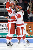 Kevin Shattenkirk (BU - 3) and Chris Connolly (BU - 12) celebrate Shattenkirk's goal which opened scoring 44 seconds into the game. - The Boston University Terriers defeated the Merrimack College Warriors 6-4 on Saturday, November 14, 2009, at Agganis Arena in Boston, Massachusetts.