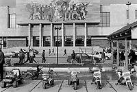 Albania. Tirana. The National Museum of History on Skandenberg Square. The impressive mosaic mural adorning the museum's facade is entitled Albania and shows Albanians victorious and proud from ancient Illyrians, Albanian nationalists and anti-Axis guerillas fighting for Albanian freedom during WWII. A row of kids' toy cars and motorbikes for rent. Skanderbeg Square is the main plaza of Tirana, named in 1968 after the Albanian national hero Skanderbeg. The National Museum of History is the country's largest museum. Tirana is the capital and largest city of Republic of Albania. 22.11.1998 © 1998 Didier Ruef