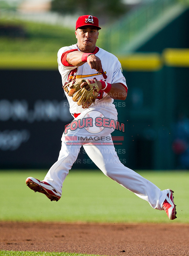 Kolten Wong (4) of the Springfield Cardinals leaps and throws to first during a game against the Arkansas Travelers at Hammons Field on May 5, 2012 in Springfield, Missouri. (David Welker/Four Seam Images)