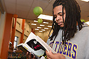 Rory Williams found his favorite book in the library at George Washington Carver High School.