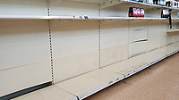 Pictured: Empty shelves at the beer section of the Tesco super market in Swansea, Wales, UK. Sunday 22 March 2020<br /> Re: Covid-19 Coronavirus pandemic, UK.