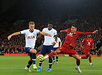 27th October 2019; Anfield, Liverpool, Merseyside, England; English Premier League Football, Liverpool versus Tottenham Hotspur; Harry Kane of Tottenham Hotspur compete for the ball with Roberto Firmino of Liverpool - Strictly Editorial Use Only. No use with unauthorized audio, video, data, fixture lists, club/league logos or 'live' services. Online in-match use limited to 120 images, no video emulation. No use in betting, games or single club/league/player publications