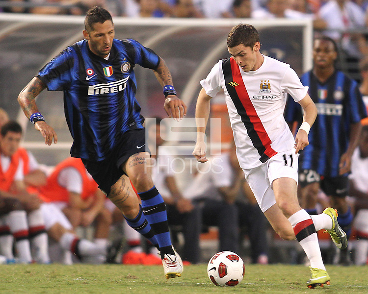 Marco Materazzi #23 of Inter Milan closes in on Adam Johnson #11 of Manchester City during an international friendly match on July 31 2010 at M&T Bank Stadium in Baltimore, Maryland. Milan won 3-0.