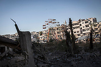In this Tuesday, Oct. 08, 2013 photo, an abandoned wheel of fortune is seen among damaged buildings due heavy fighting between opposition fighters and the Syrian army at the frontline in Maraat Al-Nouman in the Idlib province countryside of Syria. (AP/Photo)