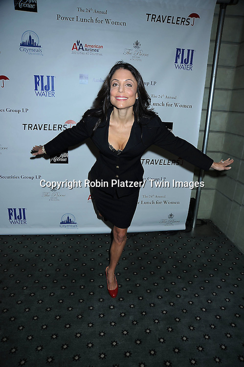 """Bethenny Frankel pretending to skate because she is going to be on """"Skating with the Stars"""" for photographers at The 24th Annual Citymeals-on-Wheels Power Lunch for Women on November 12, 2010 at The Pierre Hotel in New York City."""